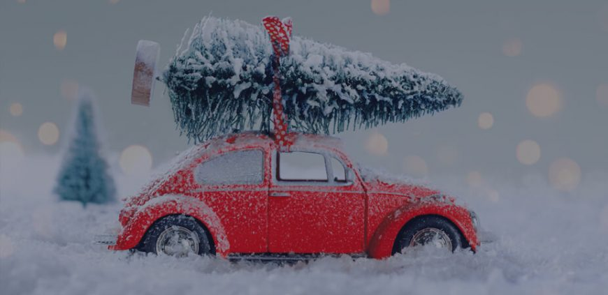 Picture of a red car with christmas tree on the roof